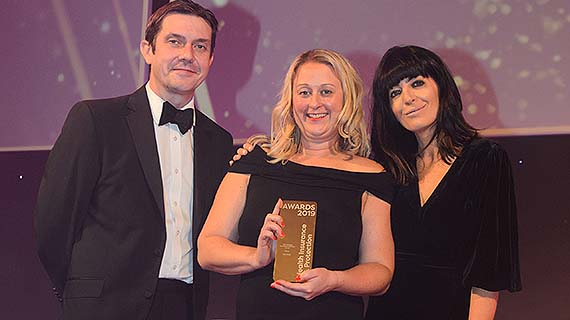 Jodie Ward, from Bupa Global, receives the Best Individual International Healthcare Provider at the Health Insurance & Protection Awards 2019, with Claudia Winkleman and Hal Cruttenden