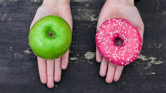 A green apple and a donut