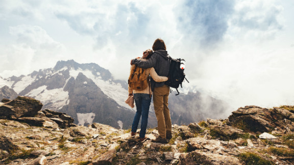 Couple hugging at the top of a mountain