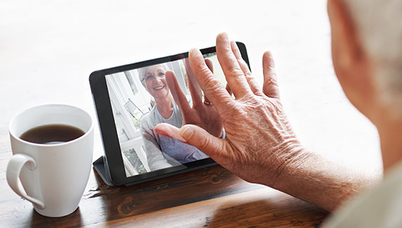 An older woman using a tablet