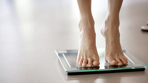 Female feet on weighing scales