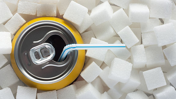 Drink can among sugar cubes