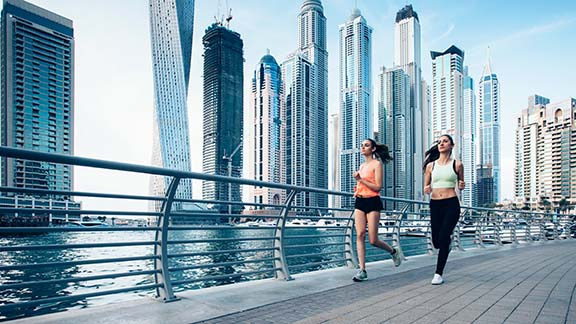 Women running in Dubai