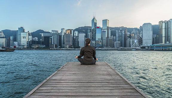 Woman meditating in Hong Kong
